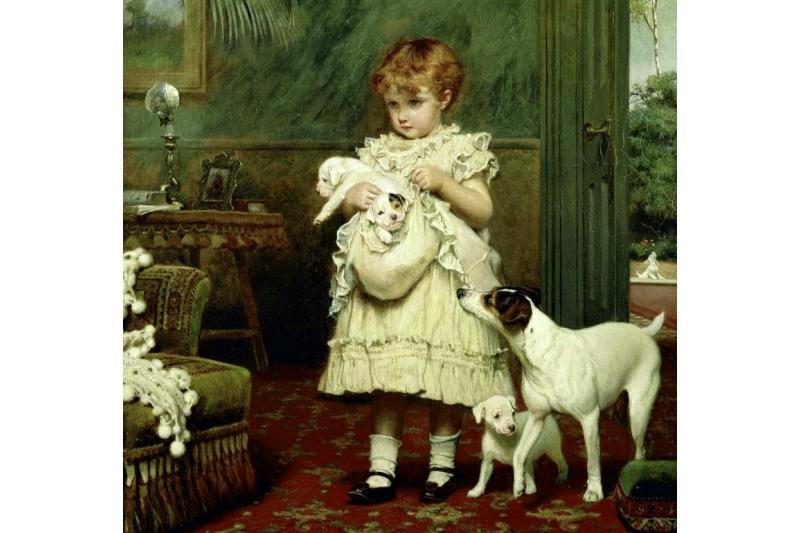 La pequeña niña con los cachorrillos