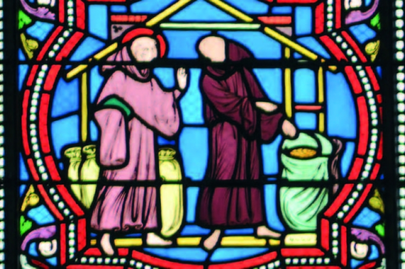 San Columbano multiplicando los alimentos para sostener a las monjas. Vidriera moderna de la abadía de Luxeuil, Francia
