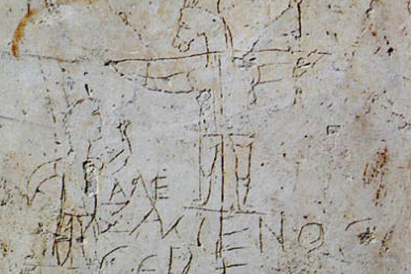 Origen y primera expansión de la Iglesia. grafito_de_alexamenos. Grabado en la pared de una escuela romana. Retrato de Jesús mas antiguo que se conoce